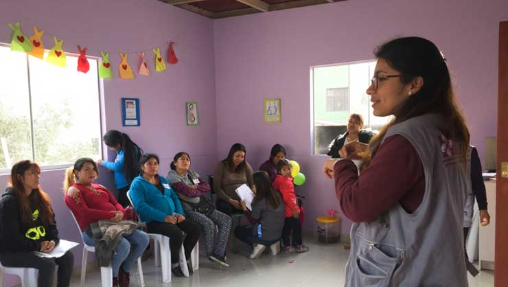 Andrea, a nutritionist at SES, leads a workshop on personal hygiene for expecting mothers