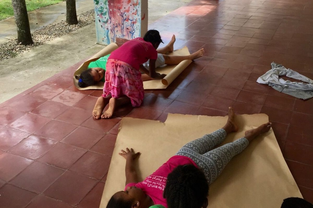 Students participating in a menstruation workshop activity