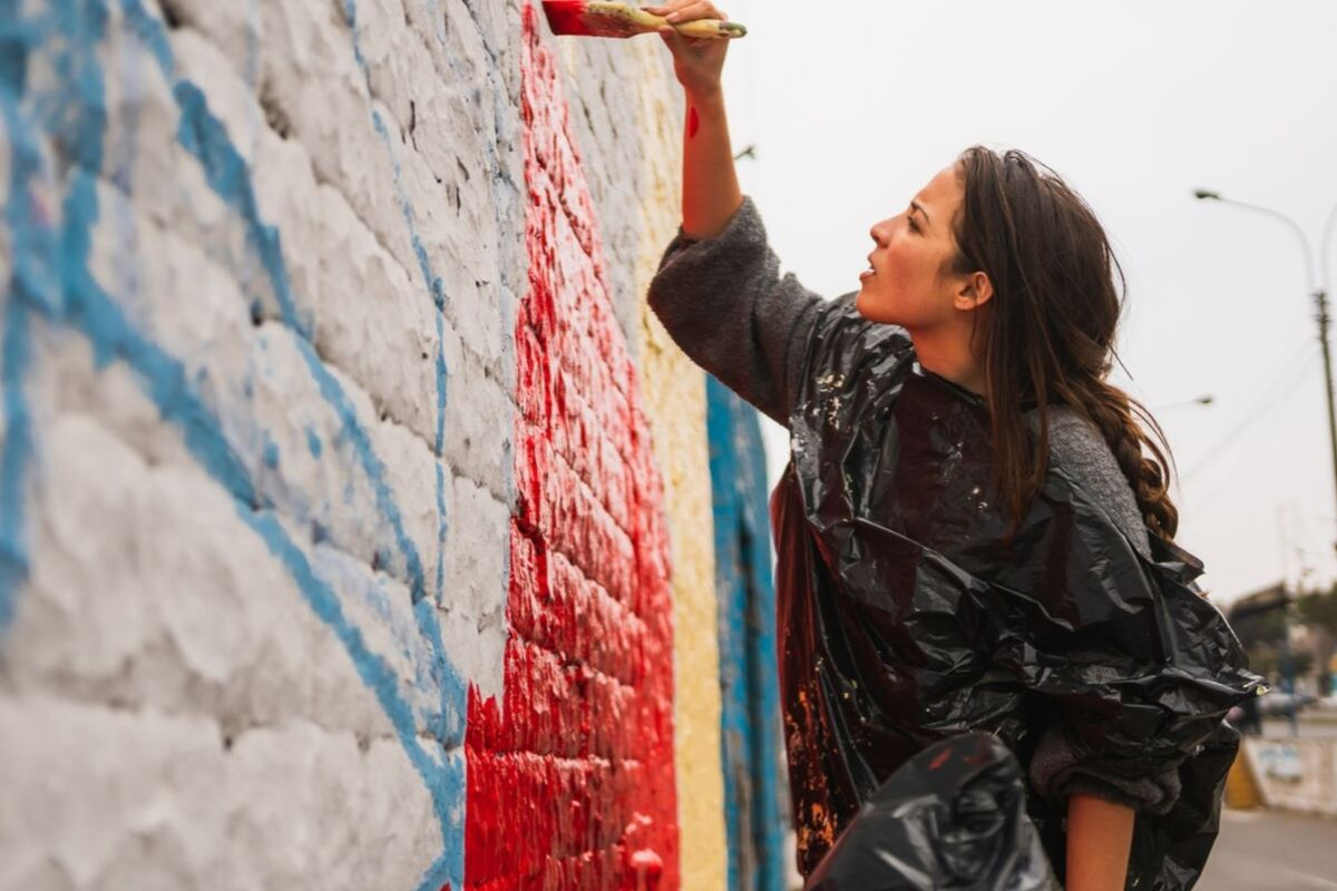 Gaby helping paint a mural