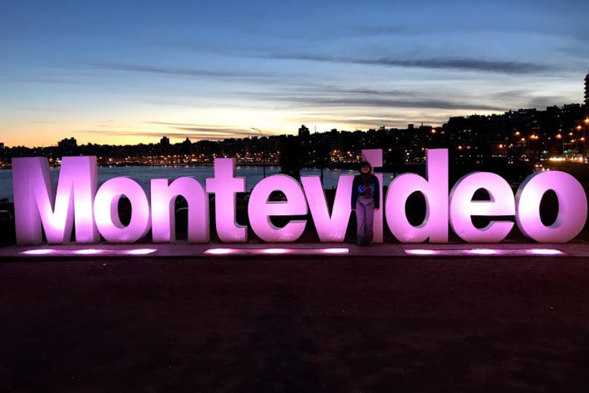Standing in front of the Montevideo sign.