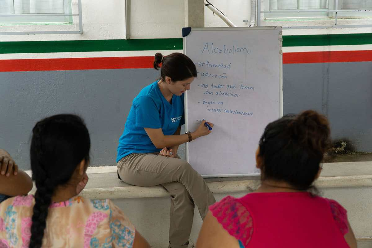 Sarah Rachel leading a continuing education course on alcoholism for community health care workers