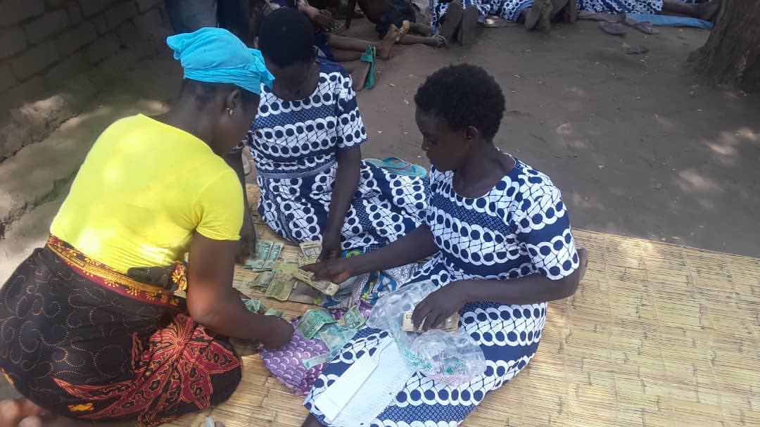 Sorting money from livestock and bicycle taxi programs to distribute to each group member