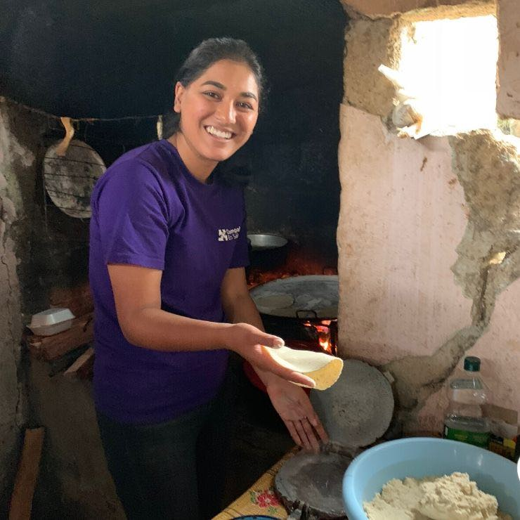 Women in the communities wake up early to make tortillas. I try my hand at it!