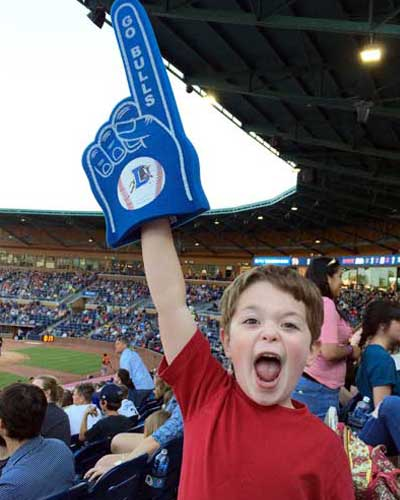 Suzanne's son waves a foam hand