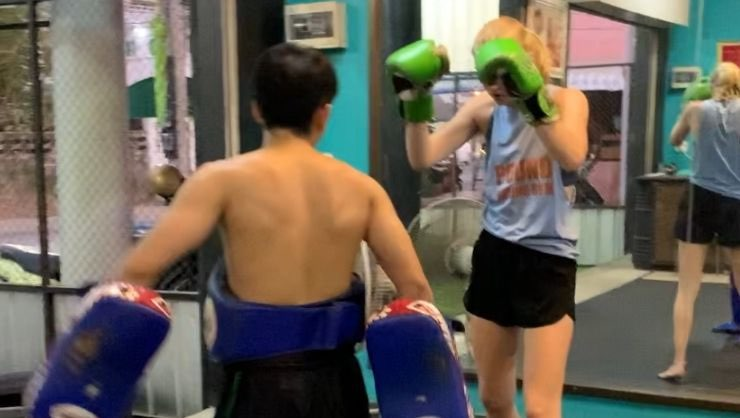 Practicing Muay Thai, a martial art popular in Thailand, at a gym in my community