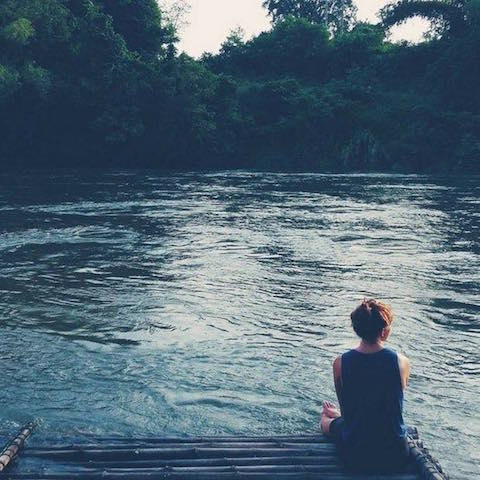 Enjoying the tranquility of River Kwai in Thailand.