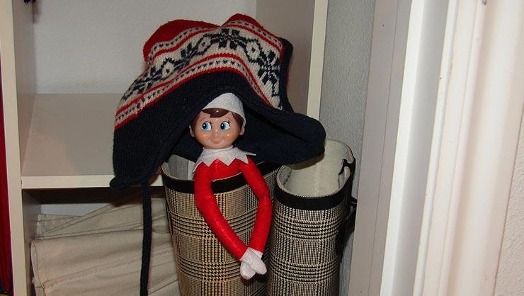 An Elf on the Shelf in a closet.