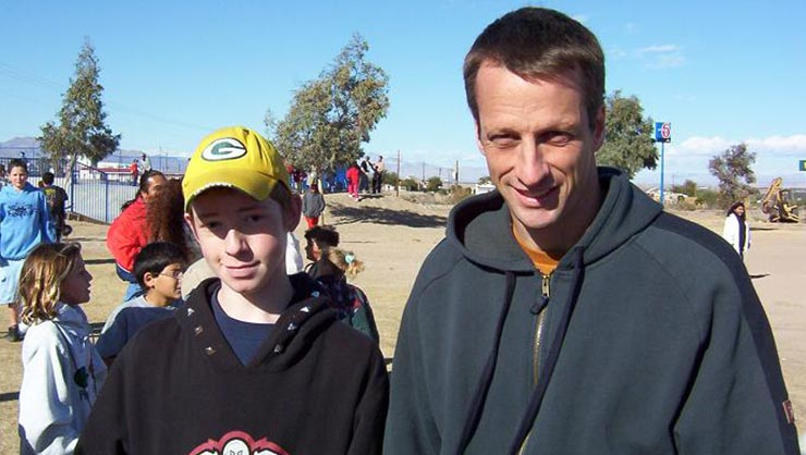 Tony Hawk and a young boy at a skatepark