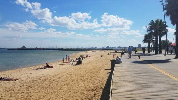 Relax and soak up the sun at St. Kilda Beach.