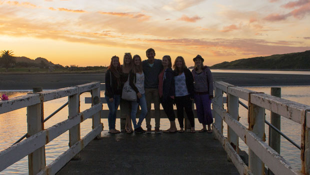 Enjoying the sunset with friends in Raglan.