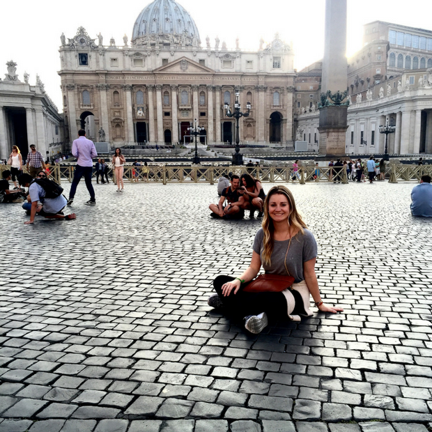 Sitting in front of St. Peter's Basilica in Vatican City.