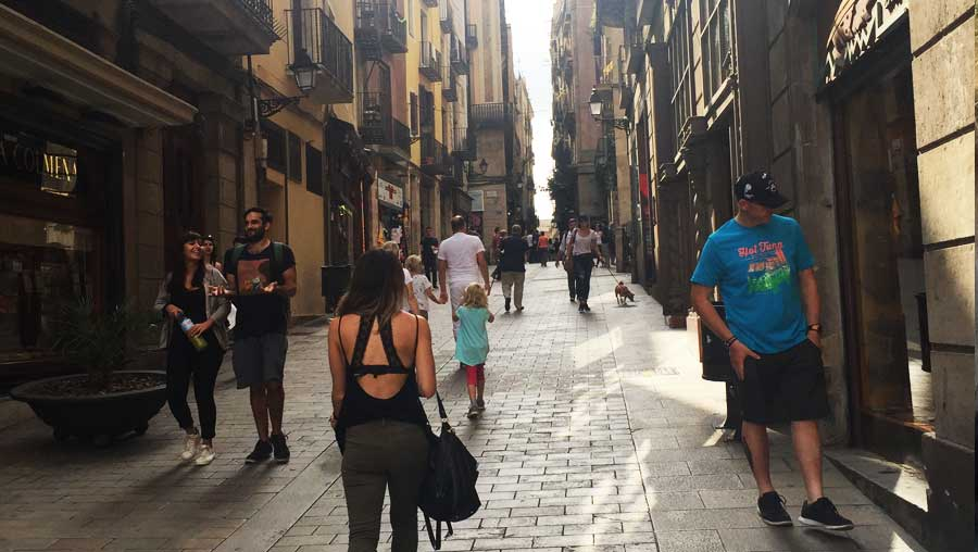 Kaila walking a Barcelona alleyway
