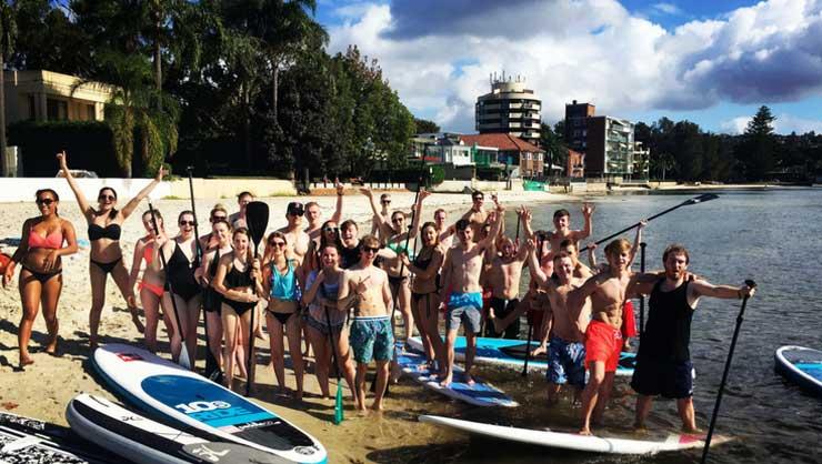 Participants paddleboarding
