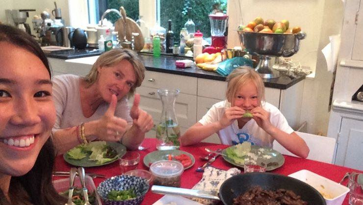 Sara S. enjoying a meal with her host family on the Au Pair Netherlands program