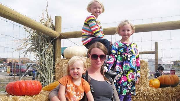 Kids with au pair in the pumpkin patch