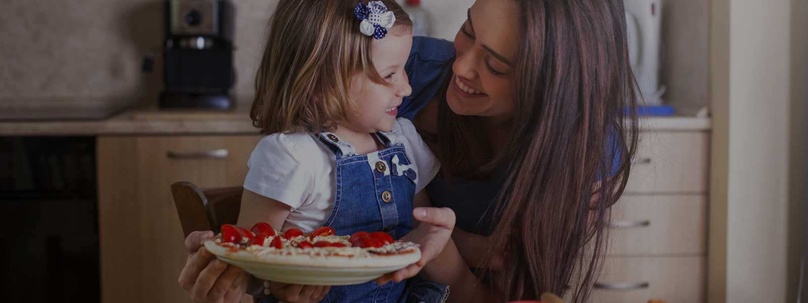 Au pair and child eating pie