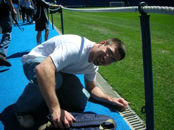Touching the grass of the field of Santiage Bernabeu in Madrid, Spain, where Real Madrid plays