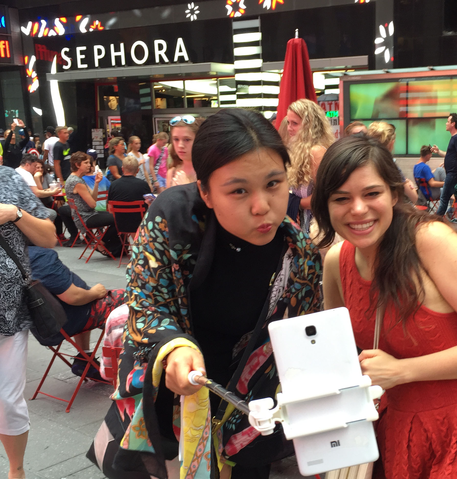 using a selfie stick in Times Square