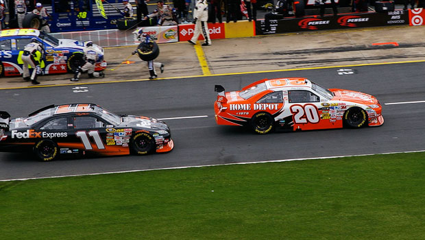 Denny Hamlin and Joey Logano drving down pit road in the 2009 Coca-Cola 600