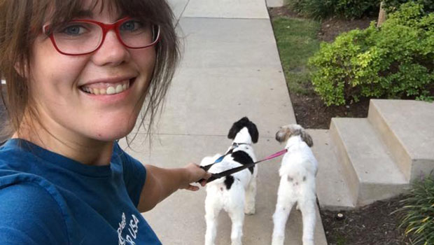 Kelly takes the family's dogs for a walk.
