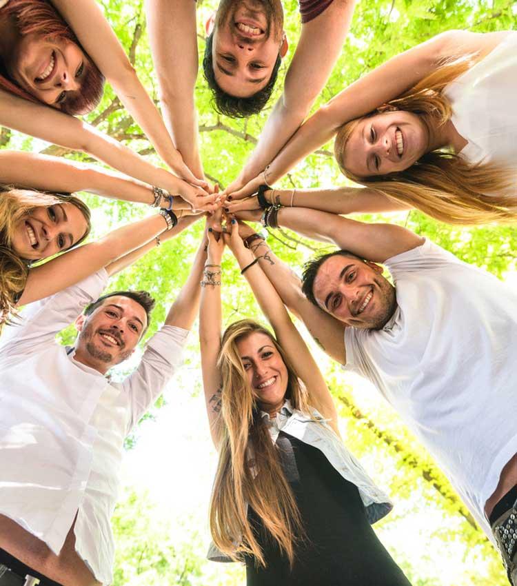 Participants holding hands