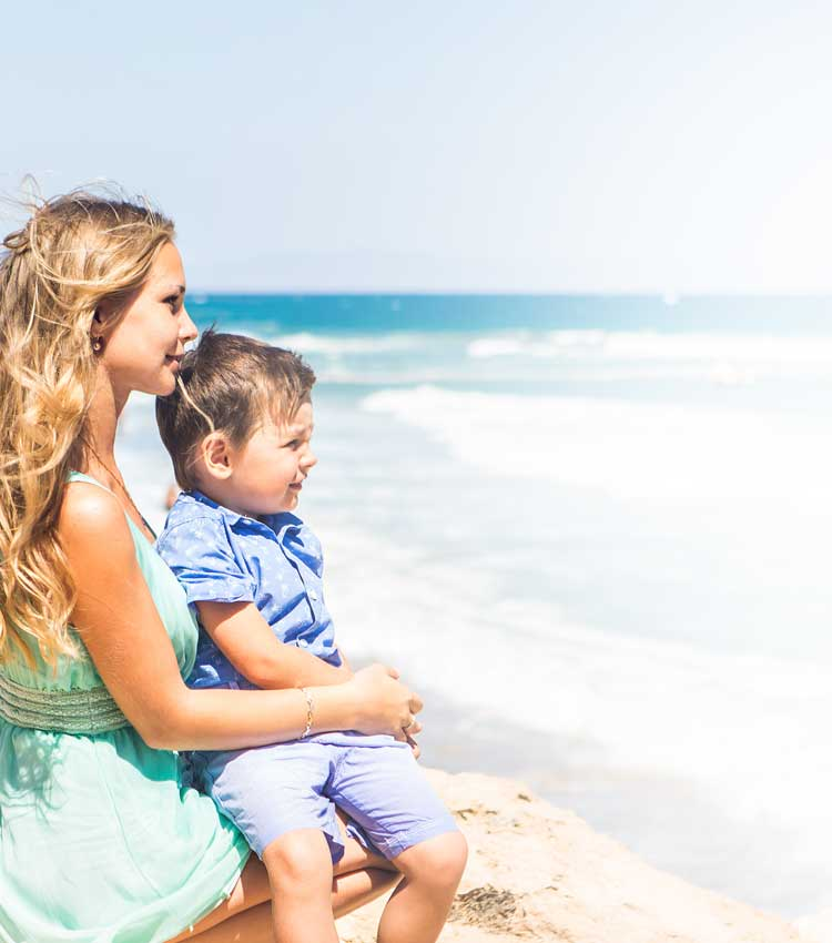 Au pair and children at the beach