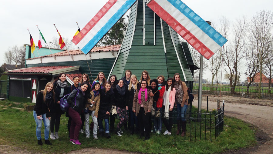 Au pairs visiting a windmill