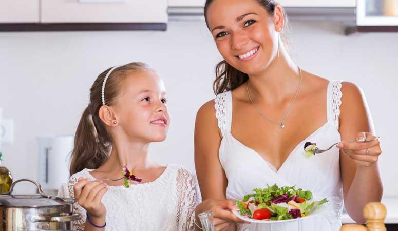 Au pair preparing meals