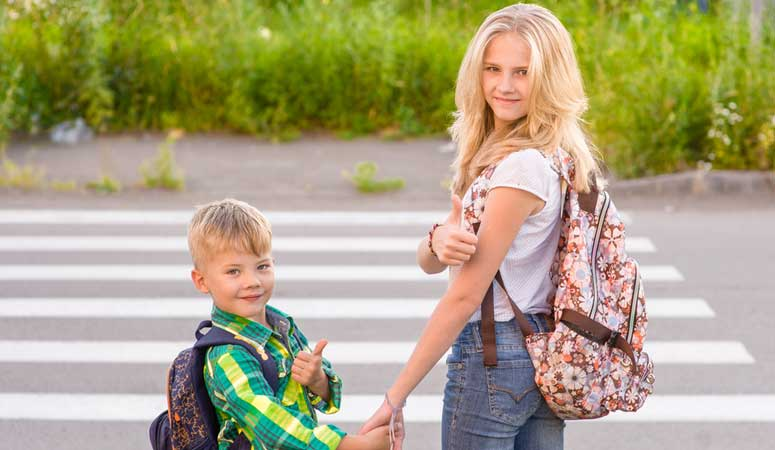 Au pair taking children to school