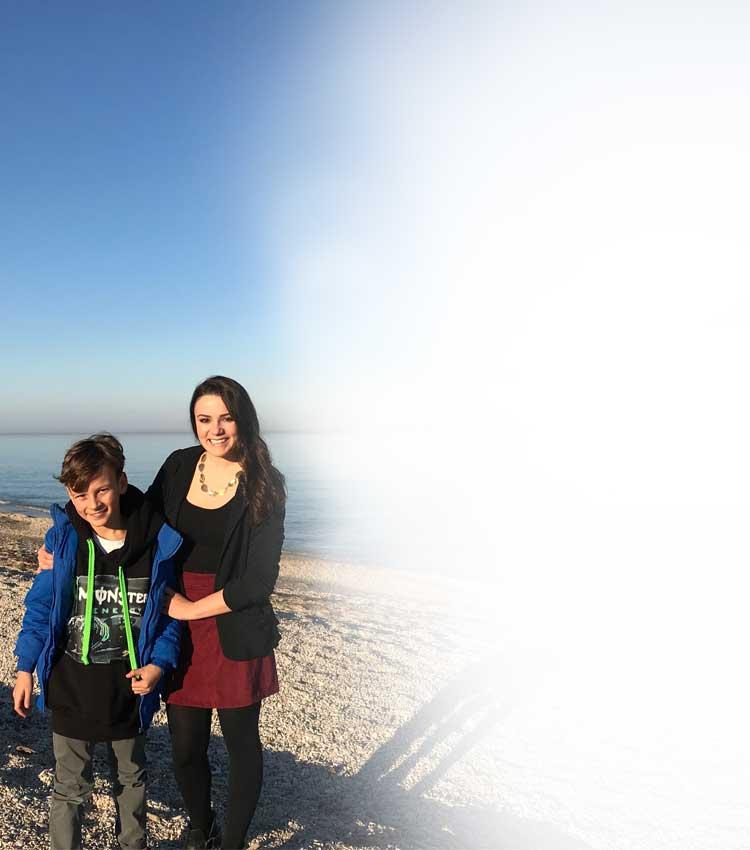 Angela and Host Child on Beach