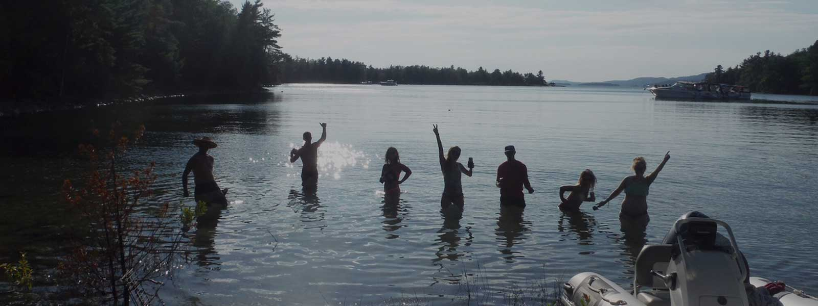 Participants jumping in lake